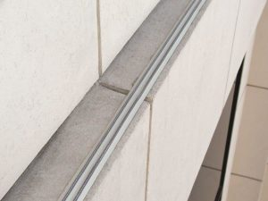 bird shock track system on ledge - beige